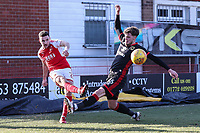 Lewis Coyle of Fleetwood Town crosses the ball under pressure from Robbie Muirhead of MK Dons during the Sky Bet League 1 match between Fleetwood Town and MK Dons at Highbury Stadium, Fleetwood, England on 24 February 2018. Photo by David Horn / PRiME Media Images