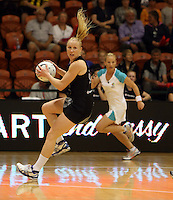 27.10.2013 Silver Fern Laura Langman in action during the Silver Ferns V Malawi New World Netball Series played at the Pettigrew Green Arena in Napier. Mandatory Photo Credit ©Michael Bradley.