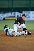 Daniel Mendick (22) of the Kannapolis Intimidators fields a throw as Andy Ibanez (7) of the Hickory Crawdads dives head first into second base at Kannapolis Intimidators Stadium on April 8, 2016 in Kannapolis, North Carolina.  The Crawdads defeated the Intimidators 8-2.  (Brian Westerholt/Four Seam Images)