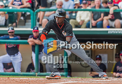 19 March 2015: Miami Marlins infielder Dee Gordon attempts a bunt during Spring Training action against the Atlanta Braves at Champion Stadium in the ESPN Wide World of Sports Complex in Kissimmee, Florida. The Braves defeated the Marlins 6-3 in Grapefruit League play. Mandatory Credit: Ed Wolfstein Photo *** RAW (NEF) Image File Available ***
