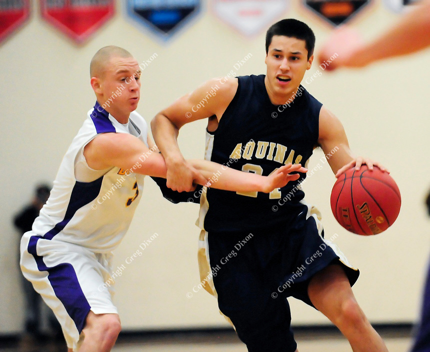 La Crosse Aquinas' Bronson Koenig gets by DeForest's Jeff Berry on Tuesday, 12/18/12, in DeForest, Wisconsin | Greg Dixon photos accompanied Dennis Semrau article in the Wisconsin State Journal on 12/19/12 and on-line at http://tinyurl.com/Bronson-Koenig-DeForest-WI