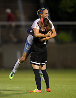 Leslie Osborne (12) of the Chicago Red Stars celebrates a goal with teammate Erin McLeod (1) during the game at the Maryland SoccerPlex in Boyds, Md.   Chicago defeated Washington, 2-0.