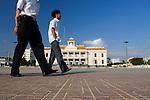 "Asia, Vietnam, Nha Trang. Walking past ""Nha Van Hoa"", Nha Trang's Vietnamese Cultural House located at the beach promenade Tran Phu."