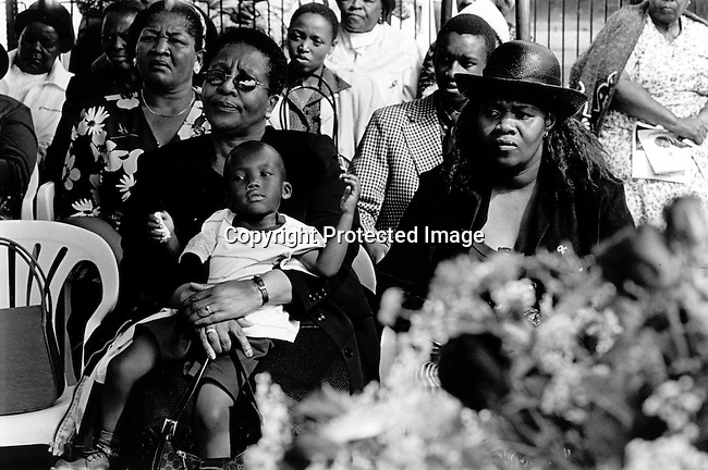 SOWETO, SOUTH AFRICA MAY 3: Unidentified relatives of Jessica Ngcongwane, age 28, who died a few days earlier in an Aids related disease on May 3, 2003 in Soweto, South Africa. She is one of many young people who is dying of HIV/Aids and she and her family decided to come out in public about her disease to help other people get rid of the stigma about Aids in their communities. HIV-Aids affects many people in South Africa, but many still have problems to talk about it. South Africa has one of the highest aids infection rates in the world and its estimated that about six hundred people die each day..Photo: Per-Anders Pettersson/ iAfrika Photos...