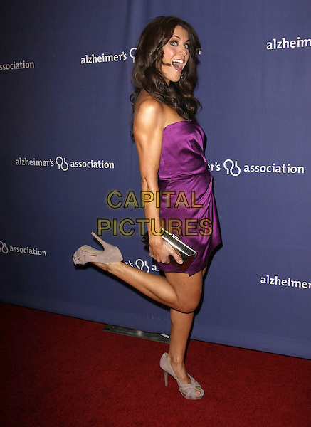 "SAMANTHA HARRIS.18Th Annual ""A Night at Sardi's"" Benefitting The Alzheimer's Association held At The Beverly Hilton Hotel, Beverly Hills, California, USA..March 18th, 2010.full length strapless purple dress leg foot up side mouth open gathered silk satin beige grey gray peep toe suede platform cut out shoes gold clutch bag.CAP/ADM/KB.©Kevan Brooks/AdMedia/Capital Pictures."