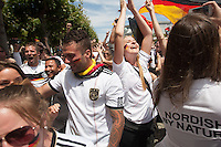 San Francisco, CA - Sunday, July 13, 2014: Germany fans celebrate winning the World Cup. Thousands of fans gathered for a public viewing at the Civic Center to watch Germany vs Argentina in the finals of the World Cup.
