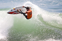 Brazilian Adriano De Souza smashes the lip of the inside section during round of 96 of the 2010 US Open of Surfing in Huntington Beach, California on August 4, 2010.