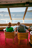 CANADA, Vancouver, British Columbia, passangers sit inside and enjoy the views off the Holland America Cruise Ship, the Oosterdam, while it navigates the Seymour Narrows in the Inside Passage North of Campbell River on the way North to Ketchikan