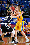BROOKINGS, SD - DECEMBER 11:  Madison Guebert #11 from South Dakota State University looks past the defense of Hannah Schaible #20 from George Washington during their game Sunday afternoon at Frost Arena in Brookings. (Photo by Dave Eggen/Inertia)