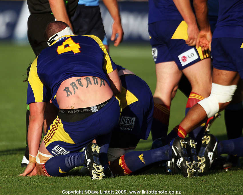 Highlanders lock Hayden Triggs shows off his lower back tattoo during the Super 14 rugby union match between the Highlanders and Bulls at FMG Stadium, Palmerston North, New Zealand on Saturday 28 March 2009. Photo: Dave Lintott / lintottphoto.co.nz