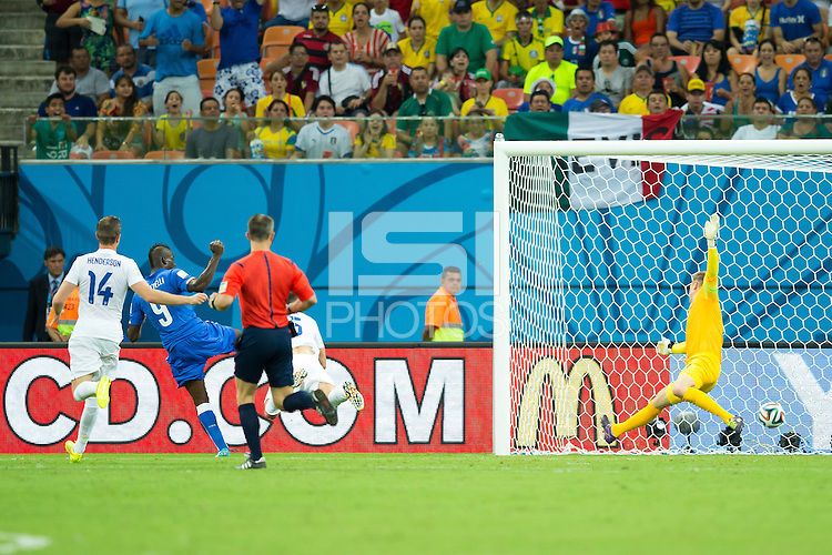 Mario Balotelli of Italy scores a goal to make it 1-2
