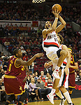 01/15/13--Portland Trail Blazers small forward Nicolas Batum (88) shoots a reverse layup against Cleveland Cavaliers shooting guard C.J. Miles (0) in the first half at Moda Center.<br />