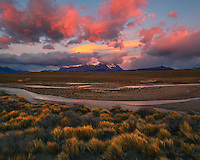 With mountains, glaciers and desert in one area, divergent weather patterns collide for sensational sunrise light.