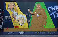 Section of the Berlin Wall depicting the painting Justitia by Klaus Niethardt, with Justice balanced against Schiller, Goethe and Einstein, damaged by graffiti, part of the East Side Gallery, a 1.3km long section of the Wall on Muhlenstrasse painted in 1990 on its Eastern side by 105 artists from around the world, Berlin, Germany. Picture by Manuel Cohen