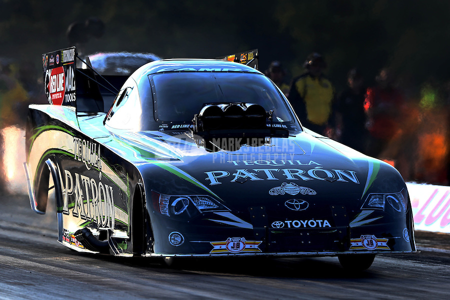 Aug. 16, 2013; Brainerd, MN, USA: NHRA funny car driver Alexis DeJoria during qualifying for the Lucas Oil Nationals at Brainerd International Raceway. Mandatory Credit: Mark J. Rebilas-