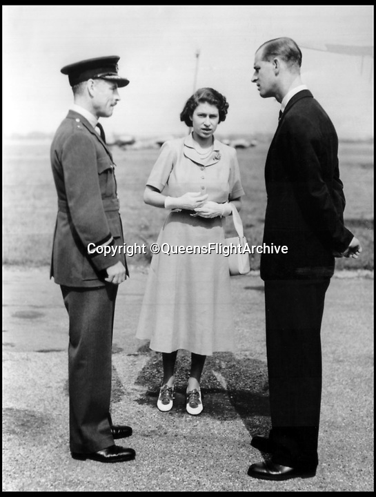 BNPS.co.uk (01202 558833)<br /> Pic: QueensFlightArchive<br /> <br /> A young Princess Elizabeth with Prince Philip and Royal Flight chief Edward Fielden in 1949.<br /> <br /> A new book gives an intimate look behind the scenes of the Royal Flight and also the flying Royals.<br /> <br /> Starting in 1917 the book charts in pictures the 100 year evolution of first the King's Flight and then later the Queen's Flight as well as the Royal families passion for aviation.<br /> <br /> Author Keith Wilson has had unprecedented access to the Queen's Flight Archives to provide a fascinating insight into both Royal and aeronautical history.