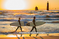 64795-01311 Surfers on beach near Grand Haven South Pier Lighthouse at sunset on Lake Michigan, Ottawa County, Grand Haven, MI