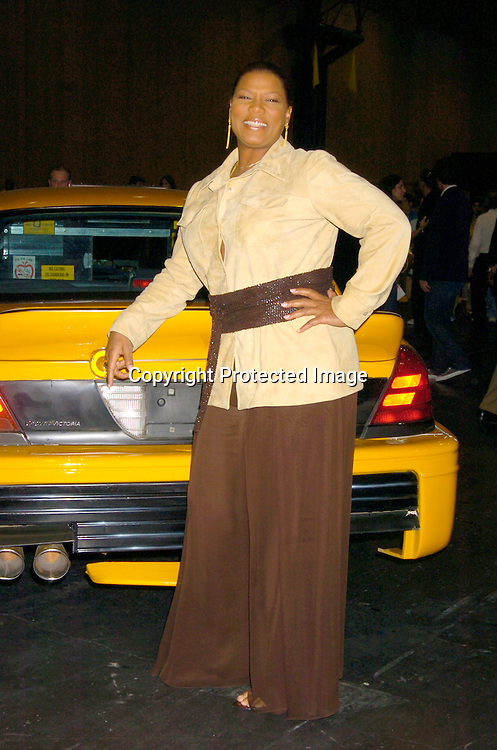"""Queen Latifah ..at the World's First ever Taxi Cab Drive-in for """"Taxi"""" ..on October 3, 2004 at the Jacob Javits Center. ..Photo by Robin Platzer, Twin Images"""