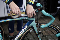 Dwars Door Vlaanderen 2013.Wesley Kreder (NLD) taping the stage hotspots to the top tube