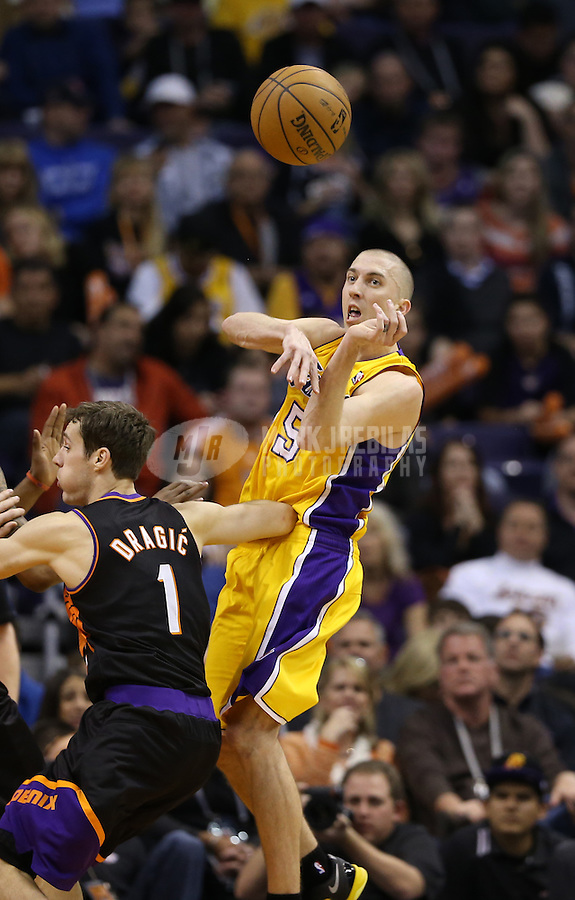 Jan. 30, 2013; Phoenix, AZ, USA: Los Angeles Lakers guard Steve Blake (5) passes the ball against the Phoenix Suns at the US Airways Center. Mandatory Credit: Mark J. Rebilas-