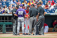 TCU Horned Frogs head coach Jim Schlossnagle (22) exchanges lineup cards with Texas Tech Red Raiders head coach Tim Tadlock (6) before in Game 3 of the NCAA College World Series on June 19, 2016 at TD Ameritrade Park in Omaha, Nebraska. TCU defeated Texas Tech 5-3. (Andrew Woolley/Four Seam Images)
