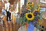 Old Bethpage, New York, U.S. 29th September 2013. In the Exhibition Hall, the sunflower flower display by Renee Translateur won 3rd Place at The Long Island Fair. A yearly event since 1842, the county fair is now held at a reconstructed fairground at Old Bethpage Village Restoration.