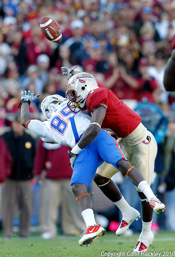 TALLAHASSEE, FL 11/27/10-FSU-UF FB10 CH-Florida State's Mike Harris knocks the ball loose from Florida's Janoris Jenkins during first half action Saturday at Doak Campbell Stadium in Tallahassee. .COLIN HACKLEY PHOTO