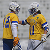 Tanner Griffin #11 of Hofstra University, right, congratulates goalie Jack Concannon #12 after their team's 7-6 win over Monmouth in an NCAA men's lacrosse game at Shuart Stadium in Hempstead, NY on Wednesday, March 14, 2018.