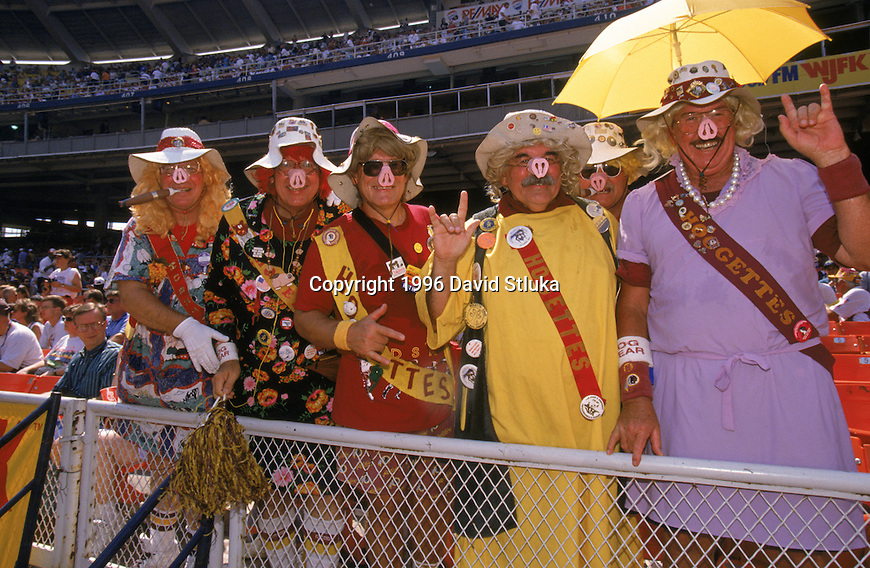 Washington Redskins fans known as the Hogettes pose in the stands during an NFL football game against the Chicago Bears at RFK Stadium on September 8,1996 in Washington, D.C. The Redskins won 10-3. (Photo by David Stluka)