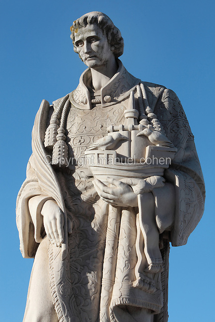 Statue of St Vincent of Saragossa or Sao Vicente de Fora, patron saint of the city, holding a boat with 2 ravens (symbols of Lisbon), at the lookout Miradouro Portas do Sol, in Alfama, the oldest district in the city and the original Moorish area, Lisbon, Portugal. Picture by Manuel Cohen