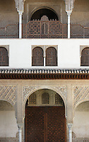 Detail of the three floors, South Gallery, Courtyard of the Myrtles, 14th century under the reign of Yusuf I, Comares Palace, Nasrid Palaces, The Alhambra, Granada, Andalusia, Spain. During the 19th century all the openings between the pillars of the upper gallery were closed off by wooden jalousies in the form of a balustrade. Picture by Manuel Cohen