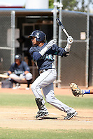 Esteilon Peguero #17 of the Seattle Mariners plays in an extended spring training game against the Texas Rangers at the Mariners complex on April 30, 2011  in Peoria, Arizona. .Photo by:  Bill Mitchell/Four Seam Images.