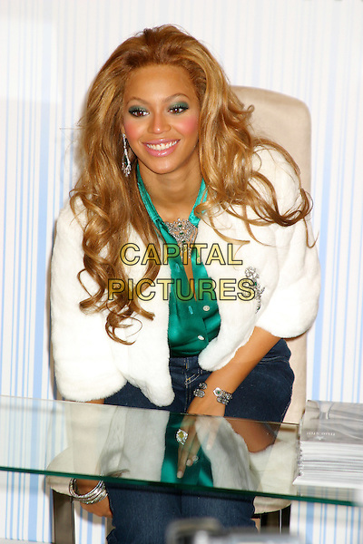 BEYONCE KNOWLES .At The True Star Perfume Launch Held At Macy's, Herald Square, New York City..October 22nd, 2004.half length, white fur coat, sitting.www.capitalpictures.com.sales@capitalpictures.com.©Capital PIctures