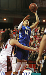 VERMILLION, SD, APRIL 2:  Whitney Knight #14 from Florida Gulf Coast lays the ball up against Kate Liveringhouse #34 from the University of South Dakota during the WNIT Championship game Saturday afternoon at the Dakota Dome in Vermillion, S.D. (Photo by Dave Eggen/Inertia)