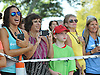 Spectators of of Northport's annual Cow Harbor 10-kilometer run watch racers cross the finish line on Saturday, September 19, 2015.<br /> <br /> James Escher