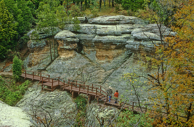 Hikers walk among rock formations at Garden of the Gods Natural Area, Illinois