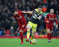 1st February 2020; Anfield, Liverpool, Merseyside, England; English Premier League Football, Liverpool versus Southampton; Pierre-Emile Hojbjerg of Southampton wins the ball from Alex Oxlade-Chamberlain of Liverpool