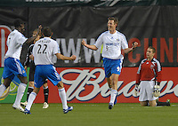 Kansas City Wizards midfielder Sasha Victorine  celebrates with teammates Davy Arnaud (22) and Eddie Johnson (7) the second goal of the game while DC United Troy Perkins looks in the back with disappointment. The Kansas City Wizards defeated DC United 4-2, in the home opening game for DC United at RFK Stadium, April 14, 2007.
