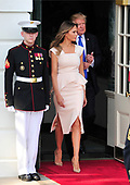 United States President Donald J. Trump and first lady Melania Trump walk out of the South Portico to welcome President Moon Jae-in of the Republic of Korea at the White House in Washington, DC on Thursday, June 29, 2017.  <br /> Credit: Ron Sachs / CNP