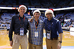 CHAPEL HILL, NC - DECEMBER 20: Photographers Bob Donnan (USATSI), Peyton Williams, and Jeffrey Camarati (UNC) wear Christmas hats for the game. The University of North Carolina Tar Heels hosted the Wofford College Terriers on December 20, 2017 at Dean E. Smith Center in Chapel Hill, NC in a Division I men's college basketball game. Wofford won the game, upsetting UNC, 79-75.