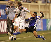 27 August 2005: Ricardo Clark of the Earthquakes tackles the ball against Chris Albright of the Galaxy during the first half of the game at Spartan Stadium in San Jose, California.   Earthquakes tied Galaxy, 1-1 at halftime.