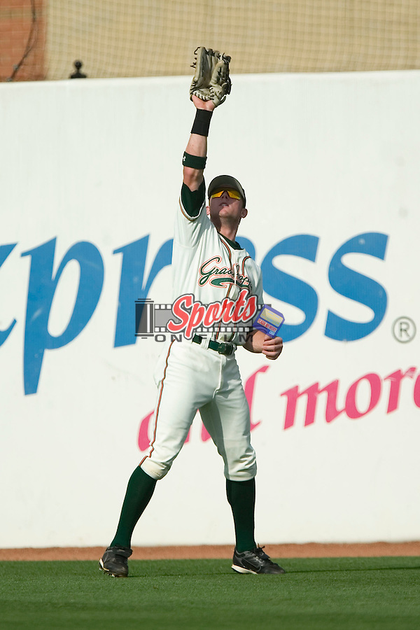 Greensboro right fielder Scott Cousins (23) catches a fly ball versus Kannapolis at First Horizon Park in Greensboro, NC, Sunday, May 27, 2007.  The Intimidators defeated the Grasshoppers 6-5.