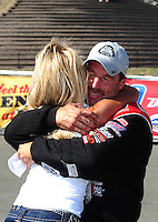 Jul. 31, 2011; Sonoma, CA, USA; NHRA pro stock driver Greg Anderson celebrates with wife Kim Anderson after winning the Fram Autolite Nationals at Infineon Raceway. Mandatory Credit: Mark J. Rebilas-
