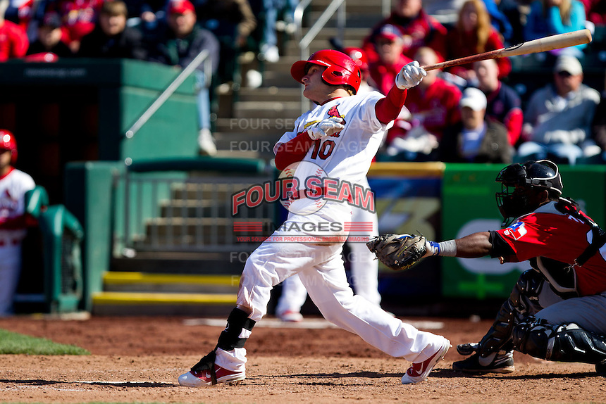 Aaron Luna (10) of the Springfield Cardinals follows through on his swing during a game against the Frisco RoughRiders on April 16, 2011 at Hammons Field in Springfield, Missouri.  Photo By David Welker/Four Seam Images