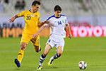 Eldor Shomurodov of Uzbekistan (R) fights for the ball with Trent Sainsbury of Australia (L) during the AFC Asian Cup UAE 2019 Round of 16 match between Australia (AUS) and Uzbekistan (UZB) at Khalifa Bin Zayed Stadium on 21 January 2019 in Al Ain, United Arab Emirates. Photo by Marcio Rodrigo Machado / Power Sport Images