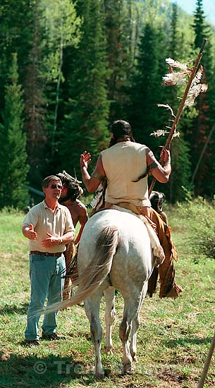 Director Lyman Dayton talks with actor Russell Means while filming of the movie &quot;Windy River.&quot;<br />