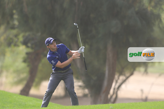 Paul Dunne (IRL) on the 1st during Round 1 of the Omega Dubai Desert Classic, Emirates Golf Club, Dubai,  United Arab Emirates. 24/01/2019<br /> Picture: Golffile | Thos Caffrey<br /> <br /> <br /> All photo usage must carry mandatory copyright credit (&copy; Golffile | Thos Caffrey)