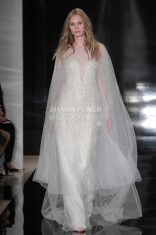 Model walks runway in a pearl/grommet embroidered illusion gown with sparkling over cape, from the Reem Acra Spring 2017 bridal collection, during New York Bridal Fashion Week Spring Summer 2017, on April 15, 2016.