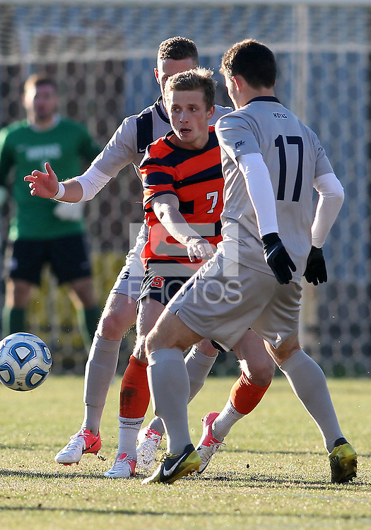 WASHINGTON, DC - NOVEMBER 25, 2012: Tom Skelly (17) of Georgetown University defends against Louis Clark (7) of Syracuse University during an NCAA championship third round match at North Kehoe field, in Georgetown, Washington DC on November 25. Georgetown won 2-1 after overtime and penalty kicks.
