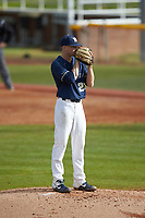 Wingate Bulldogs relief pitcher Alex Rodriguez (22) looks to his catcher for the sign against the Concord Mountain Lions at Ron Christopher Stadium on February 1, 2020 in Wingate, North Carolina. The Bulldogs defeated the Mountain Lions 8-0 in game one of a doubleheader. (Brian Westerholt/Four Seam Images)